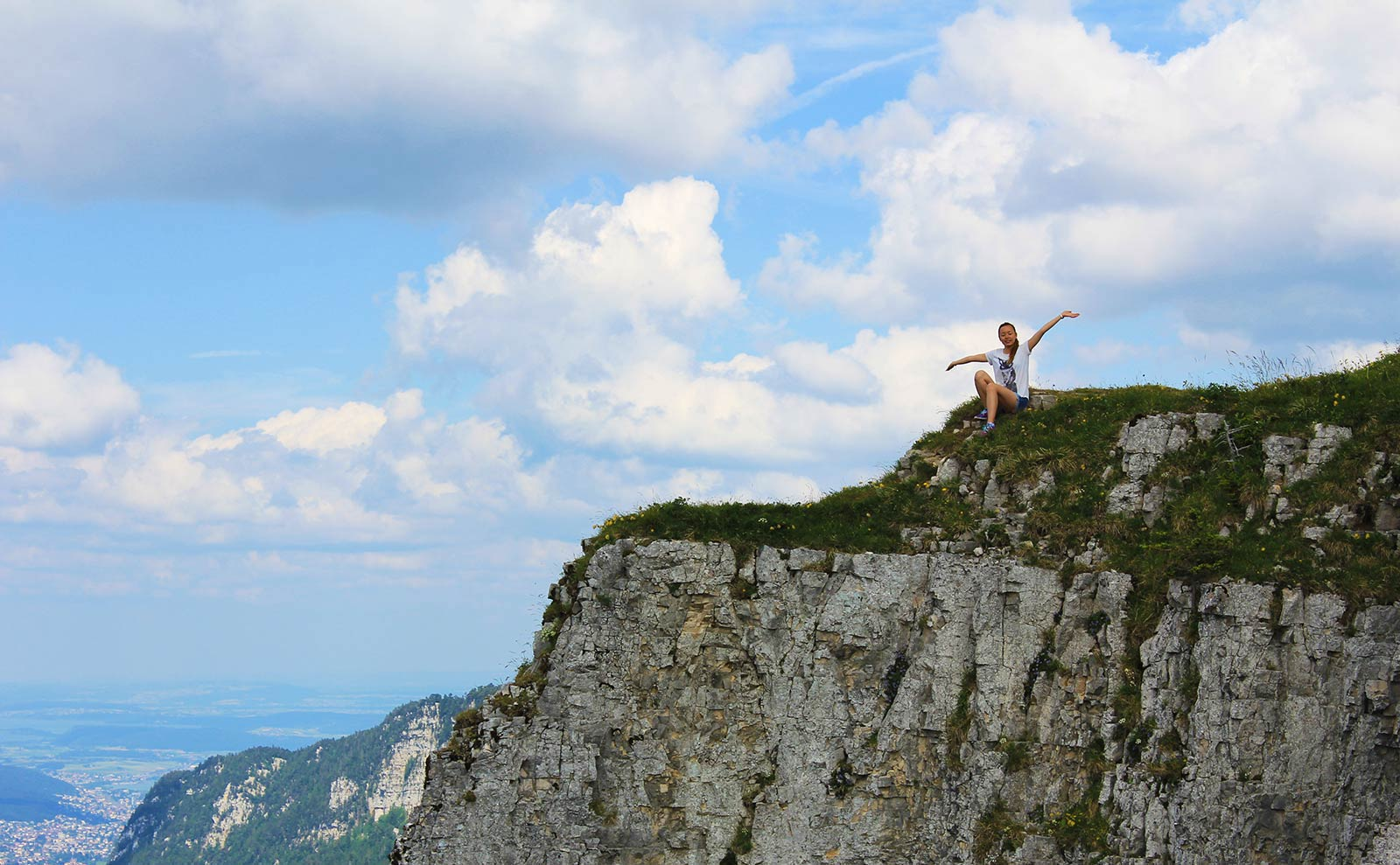 Leonie on top of the cliff edge at Creux du Van Switzerland
