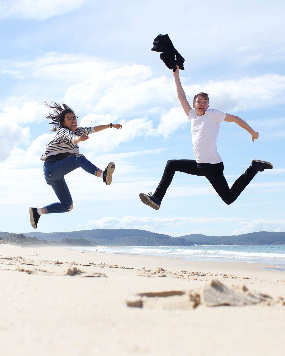 Leonie and Mattias jumping at Bruny Island
