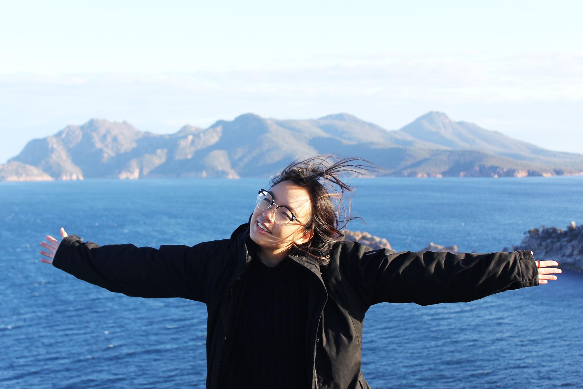 Freedom! Leonie at Cape Tourville Lighthouse Tasmania